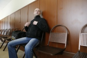 Opposition leader Sergei Udaltsov waits to attend a court hearing in Moscow