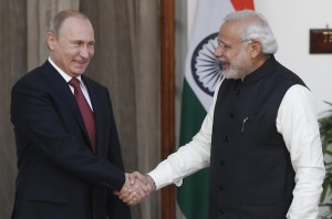 Russian President Putin shakes hands with India's Prime Minister Modi during a photo opportunity ahead of their meeting at Hyderabad House in New Delhi