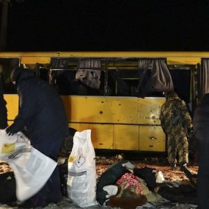 Investigators work at site were a passenger bus was damaged by shelling, at a checkpoint of the Ukrainian forces in the village of Bugas, near the town of Volnovakha in Donetsk region