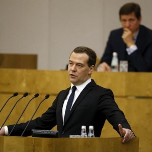 Russian PM Medvedev delivers a speech during a session at the State Duma in Moscow