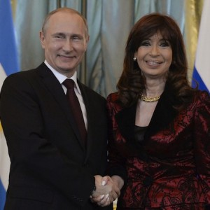 Russian President Putin shakes hands with Argentina's President Fernandez during their meeting at Kremlin in Moscow