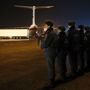 Russian emergency ministry officers wait at Pulkovo airport in St. Petersburg for the bodies of  victims of a Russian airliner which crashed in Egypt's Sinai Peninsula